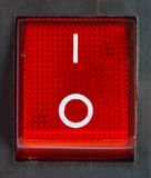 Red power switch . Close up of isolated red power on / off switch stock photo