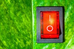 Red power switch on green leaves save World concept friendly ene royalty free stock image