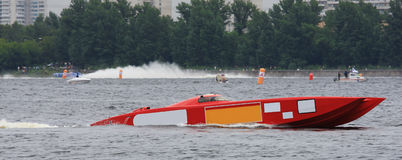 Red powerboat from f1 on water Stock Image