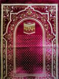 The red prayer rug is a device made of cloth that usually has an image and style that breathes Islam. Prayers are used by Muslims