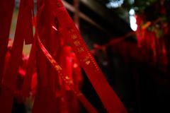 Red prayer strips of Chinese temple royalty free stock images