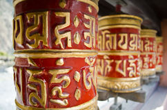Red prayer wheels in nepal Stock Photos