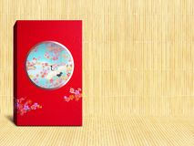 Red premium Chinese gift box for Chinese New Year, Anniversary, Mid-Autumn Festival, Valentine`s Day, Birthday. On bamboo. Background stock images