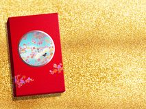 Red premium Chinese gift box for Chinese New Year, Anniversary, Mid-Autumn Festival, Valentine`s Day, Birthday. On sparkling Gold. Background stock photos