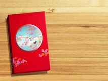 Red premium Chinese gift box for Chinese New Year, Anniversary, Mid-Autumn Festival, Valentine`s Day, Birthday. On wooden. Background stock photography