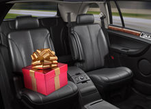 Red present. A fancy box in the passenger compartment of car Stock Image