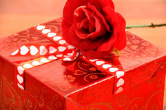 Red Present. With heart bow and red rose Royalty Free Stock Photo