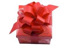 Red Present. A red present with a red ribbon isolated on the white background Stock Photo