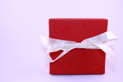 Red present box. With hearts Royalty Free Stock Images