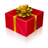 Red present box. With golden ribbon and bow Royalty Free Stock Images