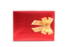 Red present box with asterisks and golden bow. Royalty Free Stock Images