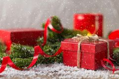 Red present box, candle and clock with snow Christmas compositio Royalty Free Stock Photo
