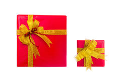 Red present box with golden bow and ribbon Stock Photos