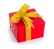 Red present box with golden bow and ribbon Royalty Free Stock Photos