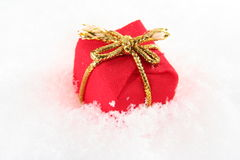 Red present box in snow Royalty Free Stock Photography