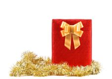 Red present box with spots and golden bow. Stock Photo