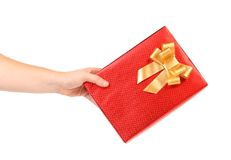 Red present box with spots and golden bow. Stock Photography
