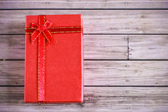 Red present box on wooden background Stock Photography