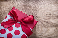 Red present box on wooden board celebrations concept.  Stock Photo