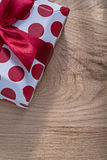 Red present box on wooden board vertical view celebrations conce Stock Image