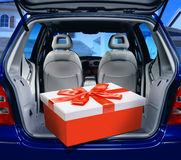 Red present in a car. A fancy box in the passenger compartment of car Stock Image