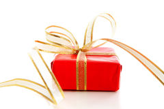 Red present with golden bow Royalty Free Stock Photography