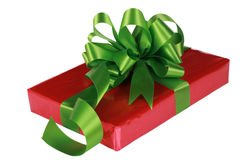 Red present with green ribbons Stock Images