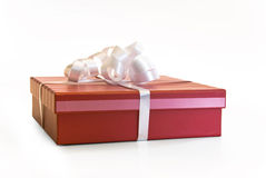 Red present with white ribbon Royalty Free Stock Photography