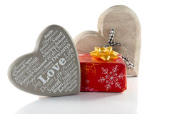 Red present with wooden heart shape and love Stock Images