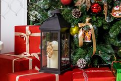 Red presents boxes under decorated New Year tree Royalty Free Stock Images