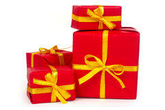 Red presents with with yellow ribbon royalty free stock photos