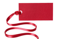 Red price tag or ticket with ribbon isolated on white background Stock Image