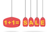 Red price tags on rope with SALE text. Stock Photo