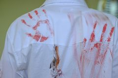 Red prints of hands on back of the shirt stock photo