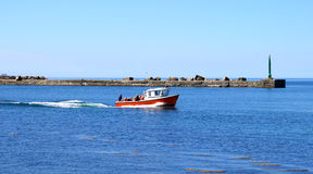 The Red promenade motorboat. The Red promenade motorboat carries the passenger stock image