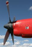 Red prop vs blue sky. An old red aircraft engine against a blue sky Royalty Free Stock Images