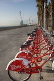 Red public bikes, public transport in square royalty free stock photography