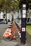 Red public bikes, public transport in square. Barcelona, Spain - October 9, 2017: red public bikes, public transport in square stock photo