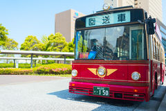 Red public bus at the bus station. Yokohama downtown, Japan. Royalty Free Stock Photos