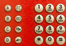 Red public phone dial pad Stock Photos