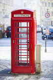 Red public phone on one of the streets. Royalty Free Stock Photography