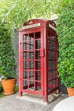 Red public telephone booth. Old-fashioned traditional red public telephone booth Royalty Free Stock Photos