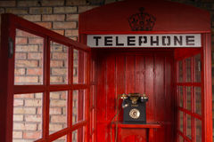 Red Public Telephone Booth with Open Door Royalty Free Stock Image