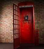Red Public Telephone Booth with Open Door Stock Photos