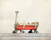 Red pull trolley toys, old rusty wagon, Vintage color tone on pastel style Stock Images