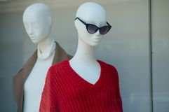 Red pullover on mannequin in fashion sotre showroom. Closeup of red pullover on mannequin in fashion sotre showroom for women stock photo
