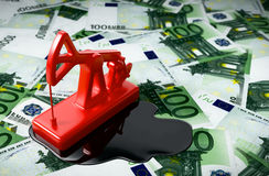 Red Pumpjack And Spilled Oil On Euros. 3D Illustration Royalty Free Stock Photo