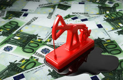 Red Pumpjack And Spilled Oil Over Euros. 3D Illustration Stock Photos