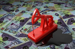 Red Pumpjack And Spilled Oil On United Arab Emirates Dirham Royalty Free Stock Photos