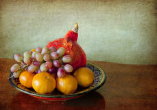 Red pumpkin, tangerines and grapes Stock Image